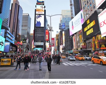 New York City - April 2 2017. Time Square, the crossroad of the world with crowds of people, street full of traffic and billboards.