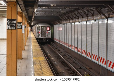New York City - April 20, 2018: 3 Train leaving the Grand Army Plaza Subway Station on the NYC Subway in Brooklyn, New York
