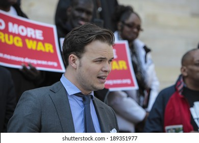 NEW YORK CITY - APRIL 25 2014: Elected officials & activists gathered in front of Brooklyn's Borough Hall in support of the DA's stance on marijuana arrests. Juvaane Williams aid reads statement
