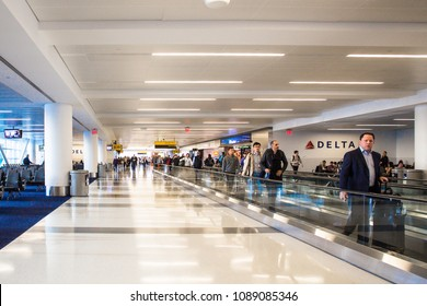 NEW YORK CITY - APRIL 27, 2018:  View inside John F. Kennedy International Airport at the Delta Airlines gate on a typical morning with passengers in view.