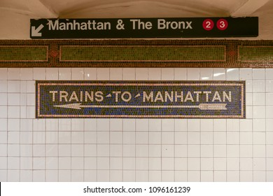 New York City - April 27, 2018: Trains to Manhattan mosaic arrow sign in the  NYC Subway.