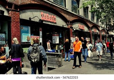 New York City - April 27,  2013:  Crowds stroll past legendary Zabar's food emporium on Broadway at West 80th Street on Manhattan's trendy Upper West Side