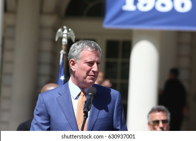 "NEW YORK CITY - APRIL 28 2017: Mayor de Blasio joined former Mets players to honor pitcher Dwight ""Doc"" Gooden for his role in the team's 1986 World Series win. Mayor Bill de Blasio announces honor"