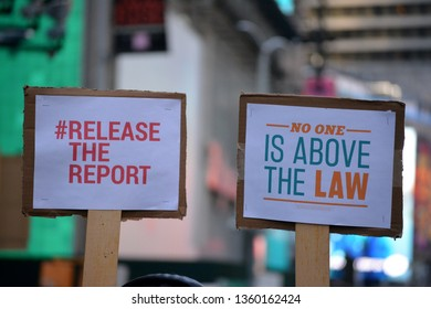 New York City - April 4, 2019: Protests in Times Square demanding the full release of the Mueller Report in Manhattan.