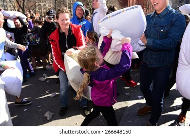 NEW YORK CITY - APRIL 4 2015: the 7th annual International Pillow Fight Day, held on the first Saturday of April, took place in Washington Square Park