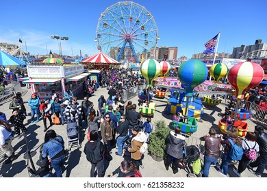 NEW YORK CITY - APRIL 9 2017: Luna Park in Coney Island celebrated its formal opening day for the 2017 season. Crowds fill Luna Park after ribbon cutting