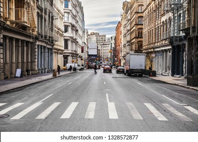 New York City asphalt road on busy intersection streets with car traffic at daytime