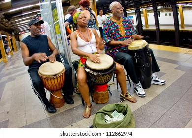 NEW YORK CITY - AUG 29:  Music Under New York African hand-drummers perform in Penn Station, NYC on Aug. 29, 2012.  MUNY has been presenting music to commuters of NYC public transit since 1985.