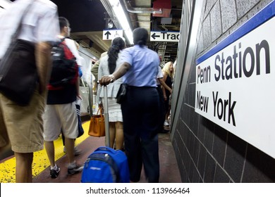 NEW YORK CITY - AUG 29:  Commuters bustle on the Long Island Railroad subway platform at Pennsylvania Station NYC on Aug. 29, 2012.  Penn Station is a train major hub serving 300,000 commuters a day.