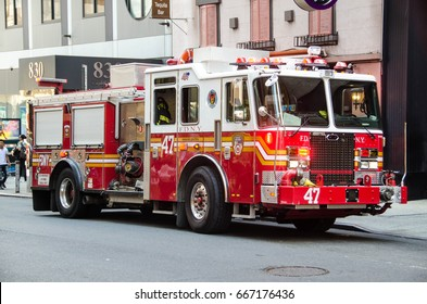 NEW YORK CITY - Augost 23 2016: Times Square, Fire truck on animated LED driving in Manhattan, New York City, is a symbol of New York City and the United States,