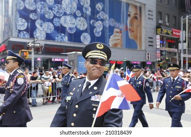 NEW YORK CITY - AUGUST 10 2014: New York City's annual Dominican Day parade filled Sixth Avenue from 39th Street with flags, float & revelry.