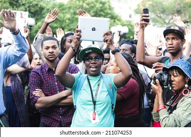 NEW YORK CITY - AUGUST 14 2014: National Moment of Silence held a vigil at sites throughout North America, including Union Square Park, in memory of Michael Brown, the Missouri teen killed by police