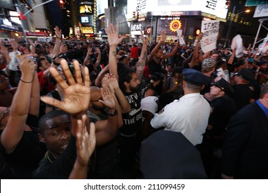 NEW YORK CITY - AUGUST 14 2014: Thousands of New Yorkers responded to Anonymous's call for a Day of Rage march & rally to demand justice for the police-related deaths of Michael Brown & Eric Garner