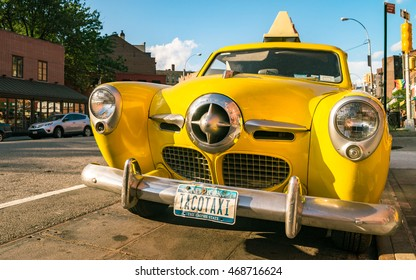 NEW YORK CITY - AUGUST 14, 2016: old yellow taxi car on NYC street. Rare yellow cab of the 50s, 60s.