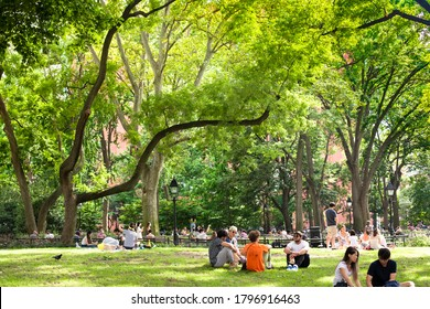 New York City - August 15, 2020:  People relaxing on a Summer afternoon scene at Washington Square Park in Manhattan.