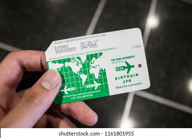 NEW YORK CITY - August 17, 2015: Hand holding an Airtrain metro ticket card for JFK international airport