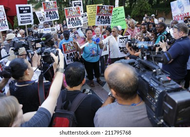 NEW YORK CITY - AUGUST 18 2014: Peoples Power Assembly staged an emergency rally at 1 Police Plaza before marching to City Hall seeking justice for Eric Garner, Michael Brown & others killed by police
