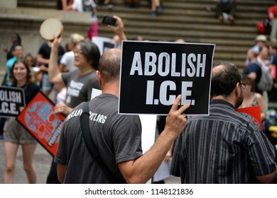 """New York City - August 2, 2018: People taking part in a """"Abolish ICE"""" protest on Wall Street in Lower Manhattan."""