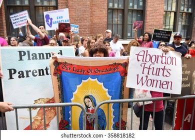 NEW YORK CITY - AUGUST 22 2015: anti-abortion activists squared off against pro-choice demonstrators in front of Planned Parenthood's Margaret Sanger Clinic on Bleecker St.