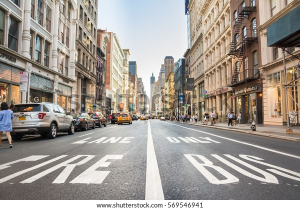 NEW YORK CITY - AUGUST 22: Street view with skyscrapers on August 22, 2016 in Manhattan, New York City. With population of 8.4M, it is the most populous city in the United States.