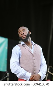 """NEW YORK CITY - AUGUST 23 2015: Thousands filled Tompkins Square Park to hear live jazz performances celebrating the life of Charlie """"Yardbird"""" Parker. Singer Michael Mwenso"""