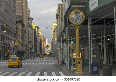 NEW YORK CITY - AUGUST 23, 2015: View along Fifth Avenue from the intersection with Broadway towards the south, early Sunday morning.