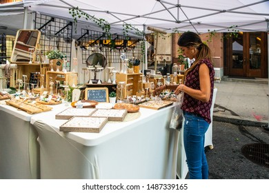 NEW YORK CITY - AUGUST 24, 2019:  View of tent street fair at Astor Place in Manhattan with people visible.