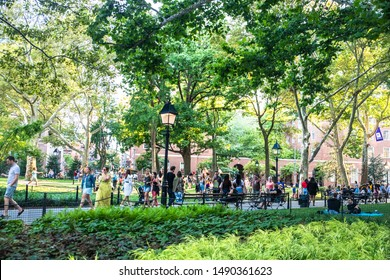 NEW YORK CITY - AUGUST 24, 2019:  View from Washington Square Park in Greenwich Village Manhattan on a summer afternoon.  People and NYU are visible.
