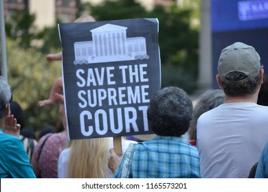 New York City, August 26, 2018 - Signs at a Unite for Justice rally against Supreme Court nominee Brett Kavanaugh in Lower Manhattan.