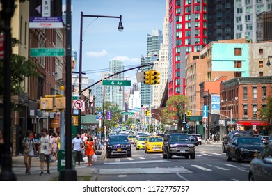 NEW YORK CITY - AUGUST 27, 2017:  Traffic drives along busy Flatbush Avenue in downtown Brooklyn.