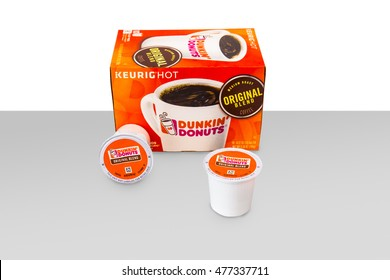 NEW YORK CITY - AUGUST 29, 2016:  Box and single serving Keurig K-cups of Dunkin Donuts Original Blend Coffee against white background