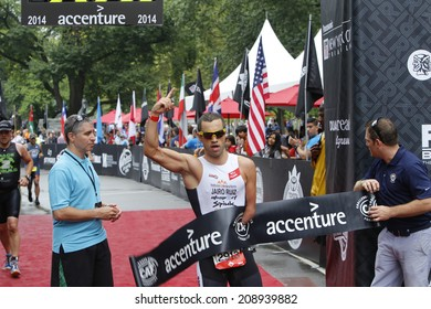 NEW YORK CITY - AUGUST 3 2014:  the 14th annual NYC Triathlon saw approximately 4000 participants of various age & skill levels swim the Hudson River, bike around Manhattan & finish in Central Park