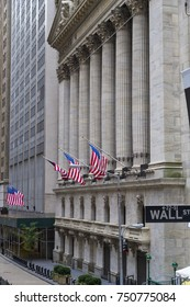 NEW YORK CITY - AUGUST 30, 2014: Wall street sign in New York with New York Stock Exchange background