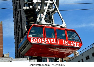 New York City - August 31, 2011:  Roosevelt Island Tram suspended from heavy steel cables en route to Manhattan
