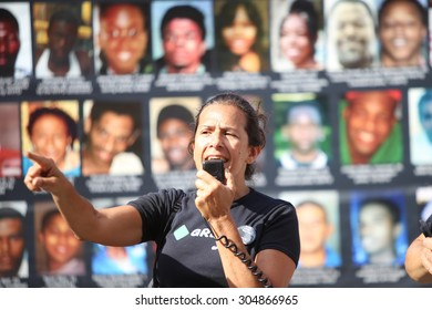 NEW YORK CITY - AUGUST 9 2014: a rally marking the one year anniversary of the shooting death of Ferguson resident Mike Brown was held at Union Square Park. Gloria Mattera of the Green Party