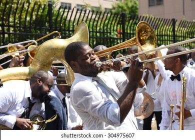 NEW YORK CITY - AUGUST 9 2015: members of the United House of Prayer for All People gathered along 116th Street in Harlem to be baptized in the church's annual tradition that uses fire hoses