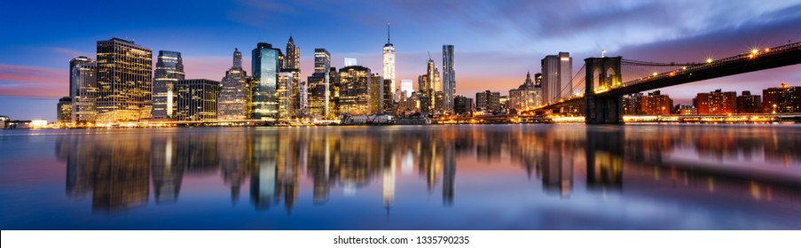 New York City - beautiful sunrise over manhattan with manhattan and brooklyn bridge USA