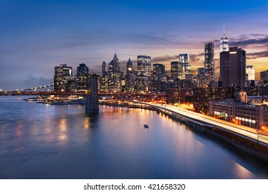 New York City - beautiful sunrise over manhattan with manhattan and brooklyn bridge USA