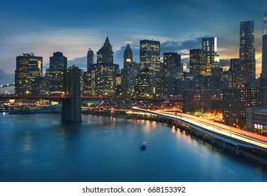 New York City - beautiful sunrise over manhattan and brooklyn bridge USA