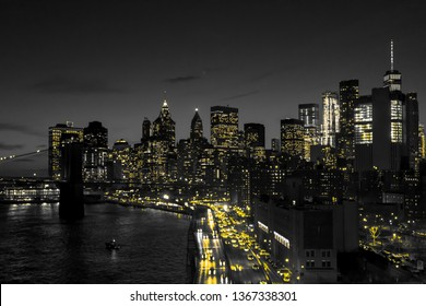 New York City black and white night skyline with golden yellow lights glowing in downtown Manhattan NYC