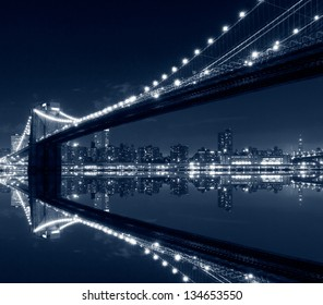 New York City, Brooklyn Bridge with reflections on water