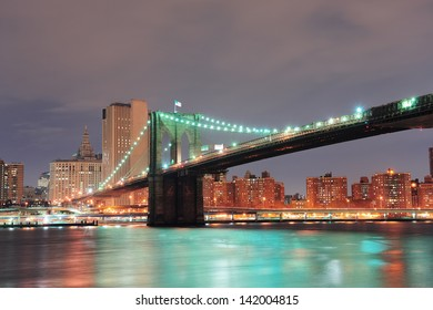 New York City Brooklyn Bridge with downtown skyline over East River.
