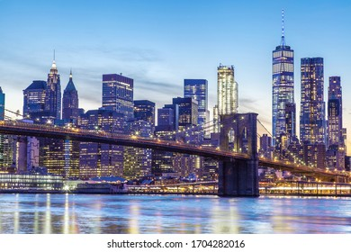 New York City and the Brooklyn Bridge at sunset along the East River