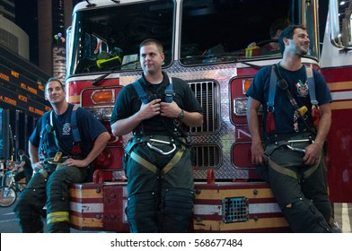 NEW YORK CITY - CIRCA 2012: Firemen near their fire car having rest after they put out a fire. New York City fire department is the second largest department in the world after Tokyo fire department.