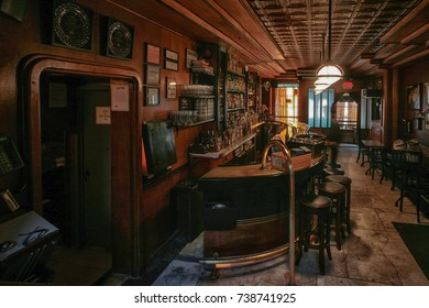New York City - Circa 2012: Interior of a bar in Manhattan, New York. Bar and bar stools. Wooden walls and ceiling.