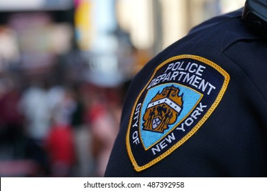 New York City - Circa 2016: NYPD sleeve patch shield on a police officer patrol in Manhattan. Protect public from terror threats and ensure safety in popular city and target for attacks.
