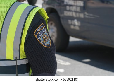 New York City - Circa 2016: NYPD sleeve patch shield on a traffic police officer patrol in Manhattan. Protect pedestrian public and transportation vehicles on busy streets to ensure safety