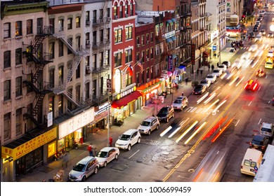 NEW YORK CITY - CIRCA 2017: Bowery street is busy with crowds of people and traffic in the colorful Chinatown neighborhood of Manhattan in New York City NYC.