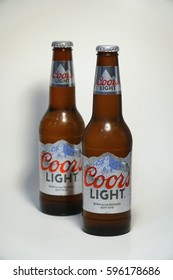 New York City - Circa 2017: Coors Light beer bottle against white background. Silver Bullet alcoholic drink branded cold as rocky mountains Colorado. Brewed in USA. Illustrative Editorial Product shot