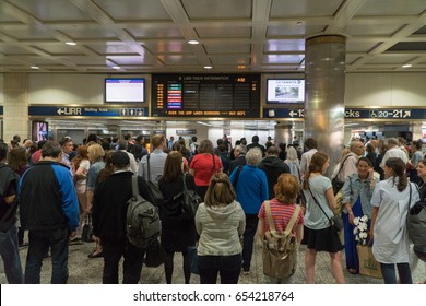 New York City, Circa 2017: Penn Station waiting area. Travelers view board for Long Island Railroad track posting announcement